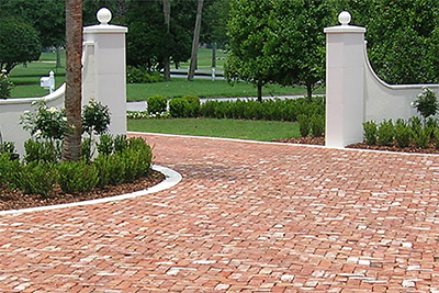 Residential driveway clay brick pavers install by Allied Paver Systems