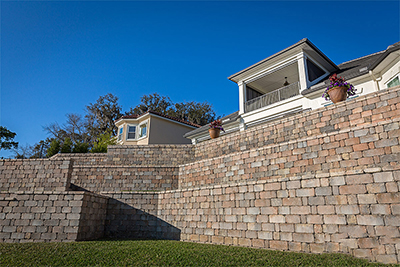 Residential multi-step retaining wall install By Allied Paver Systems
