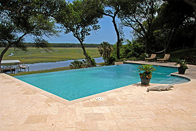 travertine pool deck install by Allied Paver Systems
